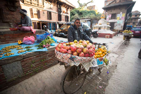 KATHMANDU, NEPAL - DEC 5: Unidentified street vendor in historic center of city, Dec 5, 2013 in Kathmandu, Nepal. Largest city of Nepal, its historic center, a population of over 1 million people.