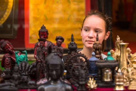 singing bowls: Teengirl in a souvenir shop in Kathmandu.