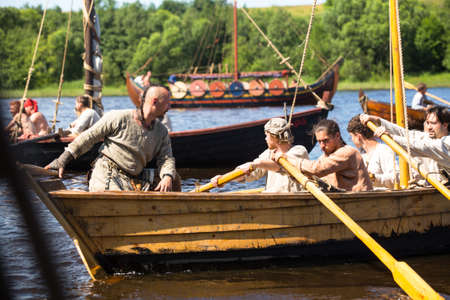 LADOGA, RUSSIA - JULY 13: During of international historical festival Ladogafest-2013 on July 13, 2013 on Ladoga, Russia. On 12-14 of July Ladoga festival will bring to life a viking age old harbour.
