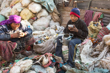 adequate: KATHMANDU, NEPAL - DEC 22, 2013: Unidentified people from poorer areas working in sorting of plastic on the dump, Dec 22, 2013 in Kathmandu, Nepal. Only 35% of population have access to adequate sanitation.