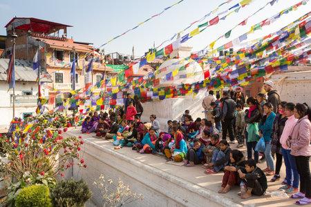 padma: KHATMANDU, NEPAL - DEC 17: Unidentified Buddhist pilgrims near stupa Boudhanath during festive solemn Puja of H.H. Drubwang Padma Norbu Rinpoches reincarnations, Dec 17, 2013 in Khatmandu, Nepal. Editorial
