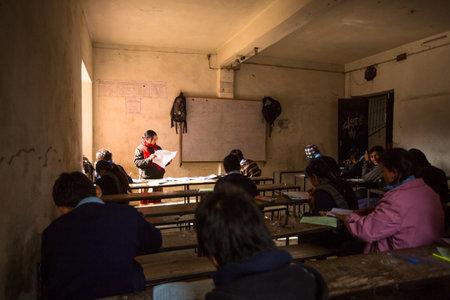 unknown age: KATHMANDU, NEPAL - DEC 19: Unknown children in the lesson at public school, Dec 19, 2013 in Kathmandu, Nepal. Adult literacy (age 15+) 60.3% (female: 46.3%, male: 73%) in a 2010 population census.