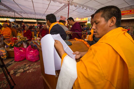 KHATMANDU, NEPAL - DEC 17: Unidentified tibetan Buddhist monks near stupa Boudhanath during festive Puja of H.H. Drubwang Padma Norbu Rinpoche's reincarnation's, Dec 17, 2013 in Khatmandu, Nepal. Stock Photo - 25420992