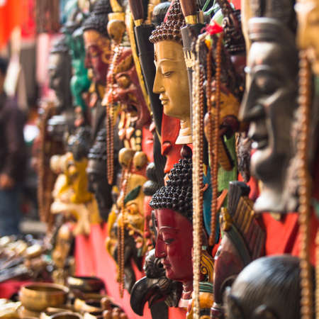 singing bowls: KATHMANDU, NEPAL - NOV 29: Masks, souvenirs in street shop at Durbar Square, Nov 29, 2013 in Kathmandu, Nepal. Preference for construction of royal palaces at Durbar Square dates back to the 3 century Editorial