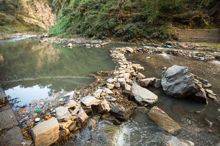 Environmental pollution in the Himalayas. Garbage in the water of Bagmati river. photo