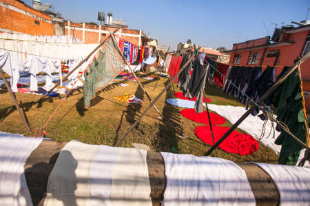 Colorful wet clothes washed. Laundry hanging in the open to dry in Kathmandu.