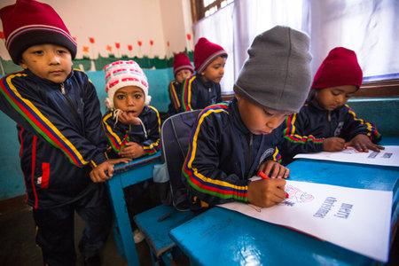 schoolroom: KATHMANDU, NEPAL - DEC 24: Unknown pupils in English class at primary school, Dec 24, 2013 in Kathmandu, Nepal. Only 50% of  children in Nepal can reach 5 grade.