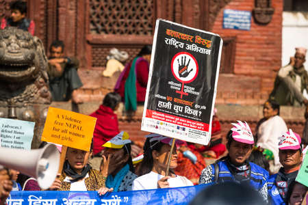 annually: KATHMANDU, NEPAL - NOV 29: Unidentified participants protest within a campaign to end violence against women (VAW), Nov 29, 2013 in Kathmandu, Nepal. Held annually since 1991, 16 days Nov 25 - Dec 10.