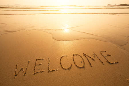 warm welcome: Welcome, texture on the beach sand.