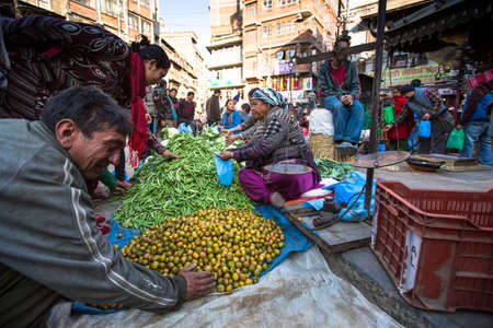 KATHMANDU, NEPAL - DEC 18, 2013: Unidentified street vendor in historic center of city. Largest city of Nepal, its historic center, a population of over 1 million people.