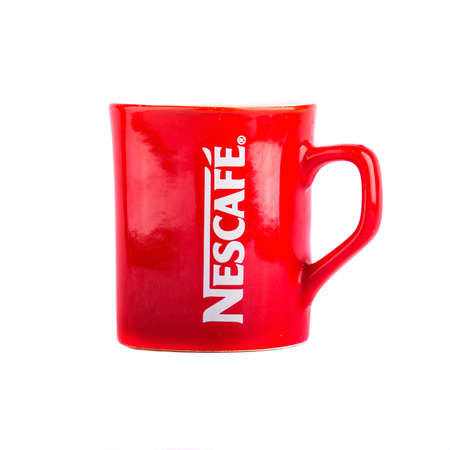 branded: KRAKOW, POLAND - FEB 3, 2014: Studio shot of a branded mug Nescafe coffee. Nescafe is a brand of Swiss food and beverage company Nestle SA - it is the largest food company in the world measured by revenues. Editorial