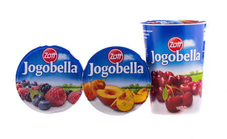 KRAKOW, POLAND - FEB 7, 2014: Studio shot of yoghurts Jogobella in assortment with different tastes. Company Zott Polska is the largest producer of dairy industry in Poland, founded 1992 in Wroclaw.