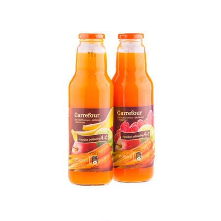 carrefour: KRAKOW, POLAND - FEB 8, 2014: Juices Carrefour in assortment isolated on white. Carrefour SA, founded 1957 - French retailer, operator retail network, the second largest in the world after Wal-Mart. Editorial