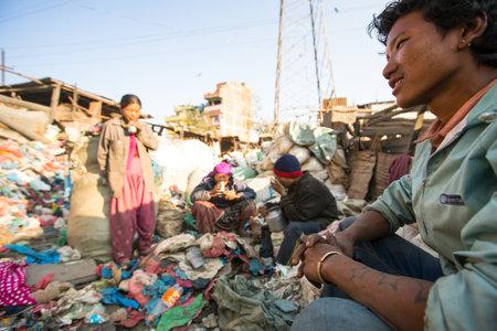 poorer: KATHMANDU, NEPAL - DEC 22, 2013: Unidentified people from poorer areas working in sorting of plastic on the dump, Dec 22, 2013 in Kathmandu, Nepal. Only 35% of population have access to adequate sanitation.