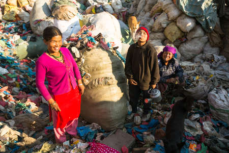 poorer: KATHMANDU, NEPAL - DEC 22, 2013: Unidentified people from poorer areas working in sorting of plastic on the dump, Dec 22, 2013 in Kathmandu, Nepal. Only 35% of population have access to adequate sanitation.
