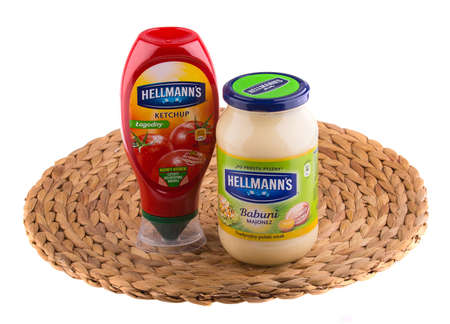 cpc: KRAKOW, POLAND - FEB 8, 2014: Studio shot of Hellmanns mayonnaise and ketchup isolated on white. Hellmanns and Best Foods brands, known as CPC international before 1997, was acquired by Unilever in 2000.