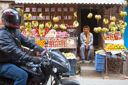 KATHMANDU, NEPAL - DEC 5, 2013: Unidentified street vendor in historic center of city. Largest city of Nepal, its historic center, a population of over 1 million people.