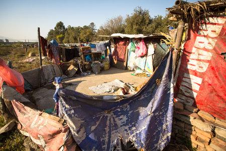slums: KATHMANDU, NEPAL - DEC 16, 2013: Illegal houses at slums in Tripureshwor district, Kathmandu. Caste of untouchables in Nepal, is about 7 % of population.