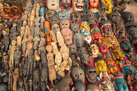 preference: KATHMANDU, NEPAL - NOV 29, 2013: Masks, souvenirs in street shop at Durbar Square. Preference for construction of royal palaces at Durbar Square dates back to the 3 century.
