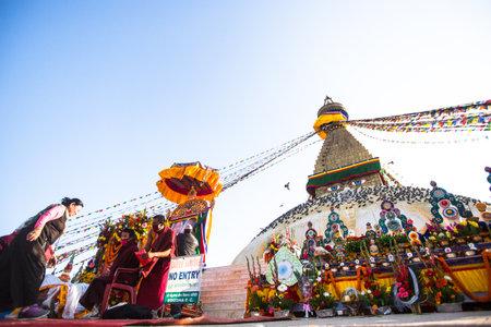 padma: KHATMANDU, NEPAL - DEC 15, 2013: Unidentified Buddhist pilgrims near stupa Boudhanath during festive solemn Puja of H.H. Drubwang Padma Norbu Rinpoches reincarnations.