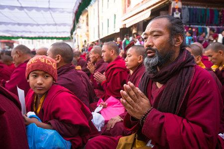 padma: KHATMANDU, NEPAL - DEC 15, 2013: Unidentified tibetan Buddhist monks near stupa Boudhanath during festive Puja of H.H. Drubwang Padma Norbu Rinpoches reincarnations.