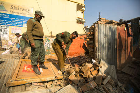 slums: KATHMANDU, NEPAL - DEC 24, 2013: Unknown nepalese police during a operation on demolition of residential slums. In KTM is home to 50,000 squatters spread across city slums. Editorial