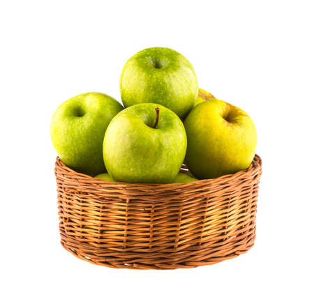 bushel: Fresh green apples in a wooden basket, isolated on white background. Stock Photo