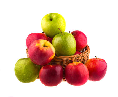 bushel: Fresh red and green apples in a wooden basket, isolated on white background.