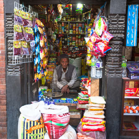 KATHMANDU, NEPAL - DEC 1, 2013: Unidentified street vendor in historic center of city. Largest city of Nepal, its historic center, a population of over 1 million people.
