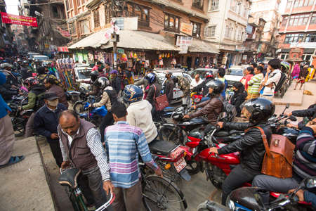 overpopulation: KATHMANDU, NEPAL - DEC 1, 2013: Traffic jam in one of a busy street in the city center. With an area of ​​50.67 km in Kathmandu city is home to more than 1 million people. Editorial