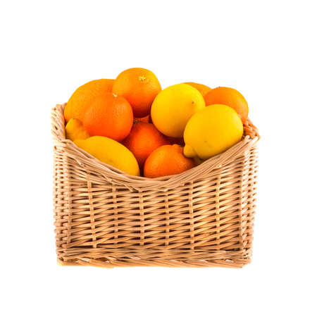 Oranges and lemons in a wooden basket, isolated on white background. photo