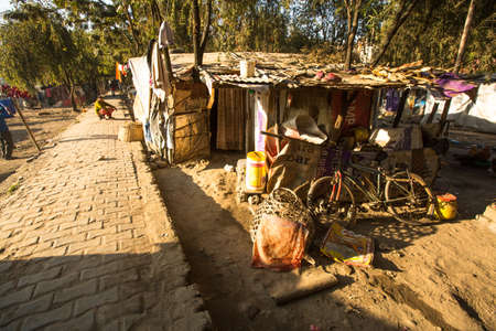 housing problems: KATHMANDU, NEPAL - DEC 16, 2013: Unidentified poor people near their houses at slums in Tripureshwor district, Kathmandu. Caste of untouchables in Nepal, is about 7 % of population.