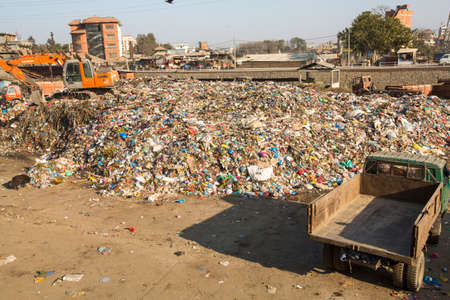 KATHMANDU, NEPAL - DEC 22, 2013: Unidentified people from poorer areas working in sorting of plastic on the dump. Only 35% of population have access to adequate sanitation.