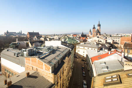 inhabitants: KRAKOW, POLAND - MAR 10, 2014: top View of the roofs of the old town in the centre. It is second largest city in Poland after Warsaw, 760 thousand inhabitants, with its nearest suburbs 1.2 million.
