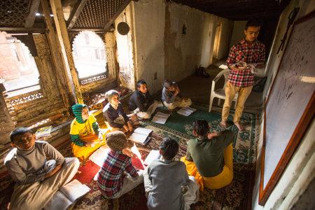 KATHMANDU, NEPAL - DEC 9, 2013: Unknown children in lesson at Jagadguru School. School established at 2013, to let new generation learn Sanskrit and preserve Hindu culture. Stock Photo - 26842338