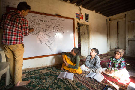 KATHMANDU, NEPAL - DEC 9, 2013: Unknown children in lesson at Jagadguru School. School established at 2013, to let new generation learn Sanskrit and preserve Hindu culture.