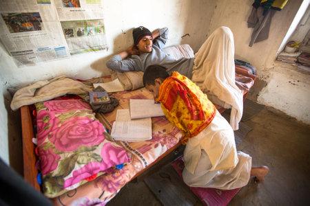 KATHMANDU, NEPAL - DEC 9, 2013: Unknown children doing homework at Jagadguru School. School established at 2013, to let new generation learn Sanskrit and preserve Hindu culture. Stock Photo - 26842343