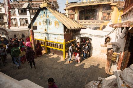 padma: KHATMANDU, NEPAL - DEC 17, 2013: Unidentified Buddhist pilgrims near stupa Boudhanath during festive solemn Puja of H.H. Drubwang Padma Norbu Rinpoches reincarnations.