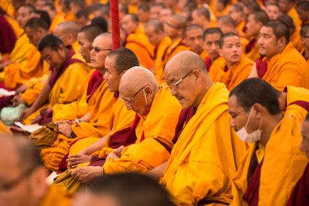padma: KHATMANDU, NEPAL - DEC 17, 2013: Unidentified tibetan Buddhist monks near stupa Boudhanath during festive Puja of H.H. Drubwang Padma Norbu Rinpoches reincarnations.