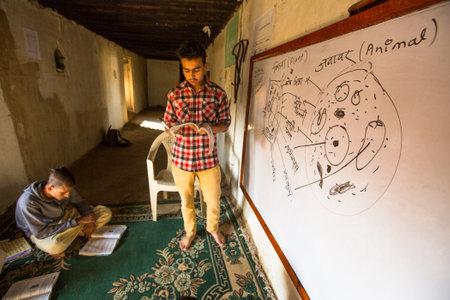 sanskrit: KATHMANDU, NEPAL - DEC 9, 2013: Unknown children in lesson at Jagadguru School. School established at 2013, to let new generation learn Sanskrit and preserve Hindu culture.  Editorial