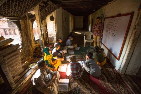 KATHMANDU, NEPAL - DEC 9, 2013: Unknown children in lesson at Jagadguru School. School established at 2013, to let new generation learn Sanskrit and preserve Hindu culture. Stock Photo - 26842374
