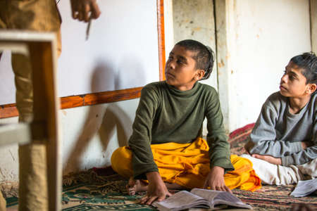 KATHMANDU, NEPAL - DEC 9, 2013: Unknown children in lesson at Jagadguru School. School established at 2013, to let new generation learn Sanskrit and preserve Hindu culture. Stock Photo - 26842376
