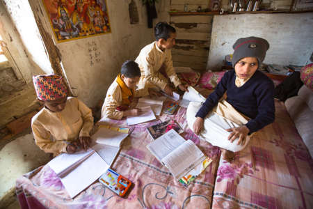KATHMANDU, NEPAL - DEC 9, 2013: Unknown children doing homework at Jagadguru School. School established at 2013, to let new generation learn Sanskrit and preserve Hindu culture. Stock Photo - 26842381