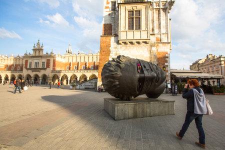 eros: KRAKOW, POLAND - FEB 28, 2014: Igor Mitorajs sculpture Eros Bendato (Eros Tied) 1999 on main square of the city. This worth about half a million euros bronze sculpture was donated to Krakow for free.
