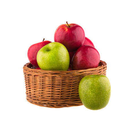 bushel: Red and green apples in a wooden basket on white background.