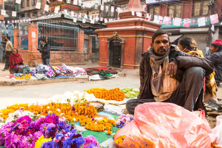 KATHMANDU, NEPAL - NOV 28, 2013: Unidentified street vendor in historic center of city. Largest city of Nepal, its economic center, a population of over 1 million people.