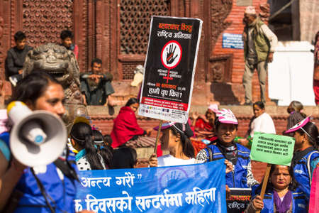 annually: KATHMANDU, NEPAL - NOV 29, 2013: Unidentified participants protest within a campaign to end violence against women (VAW) Held annually since 1991, 16 days from Nov 25 to Dec 10.