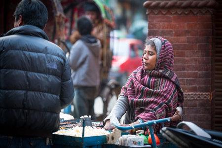 KATHMANDU, NEPAL - NOV 29, 2013: Unidentified street vendor in historic center of city. Largest city of Nepal, its economic center, a population of over 1 million people.