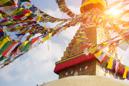 the stupa: Bodhnath Stupa with Buddha Eyes during sunrise in Kathmandu.
