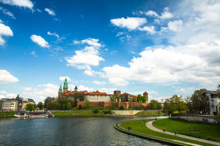 KRAKOW, POLAND - APR 21, 2014: View of Royal Wawel castle with park. The monument to the history of the Decree of the President Lech Walesa on Sep 8, 1994.
